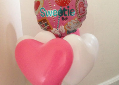 Sweetie foil balloon with 4 latex hearts